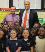 Misha and students standing next to Mayor Corey Booker