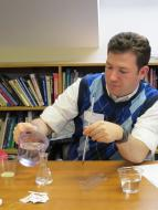 Sean Hammer demonstrating a science experiment